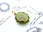 Define your design moonstoon and peridot