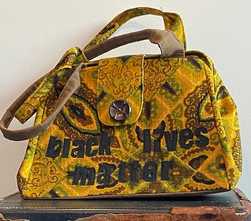 """funky 1970's """"black lives matter"""" evelyn bag"""