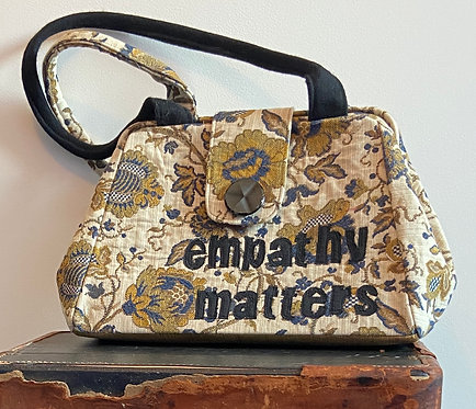 """empathy matters"" tapestry, evelyn bag"