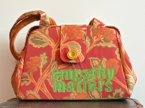"""empathy matters"" evelyn bag"