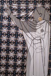 """""""The theme for this exhibition was de-centering, and I wanted to respond by de-centering the narrative of the white male achievements that can often be found within museum and gallery settings and center the many often forgotten achievements of revolutionary Muslim women instead.    The piece explores the erasure that Muslim women have faced throughout history. Its title 'Thawra', meaning 'Revolution', is a term and concept which gained momentum and notoriety in the protests of the Arab Spring. The work is comprised of a pattern woven through columns of gold thread. It features an unwoven outline of Alaa Salah, one of many Sudanese women leading protests against the government in April 2019. This image of Salah taken by Lana Haroun went viral on social media, but largely within Muslim communities/echo chambers, which has fuelled my interest in how social media works to perpetuate this erasure. Salah has since risen to be a prominent contemporary symbol of Muslim female leadership in the world today.  The pattern woven within includes images or symbols of other revolutionary Muslim women including Asma Jahangir, Dr. Hawa Abdi, Fatima Ahmed Ibrahim, a tile from the Fatima Al Fihri Al Qarawiyyin University, and the shrine of Sayyidah Zainab Bint Ali. This work centers around the theme of Muslim Female empowerment. This piece is an homage to six different Muslim women of all ages, backgrounds and across generations (626 AD - 2019) with two common threads that weave them together, they are Muslim women and they have spoken up and challenged the oppressive regimes of their time.  The only thread that ties these women together is their faith and their refusal to be silent. Religion is so often vilified as a tool of oppression for Muslim women, and indeed in the hands of men it has been weaponised against women throughout history. It is inspiring to see how, in their agency, faith is a source of liberation for these women and so I hope this piece showcases the emancipatory """