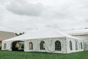 White tent with cathedral window sides