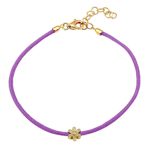 14k yellow gold diamond flower on a purple rope bracelet