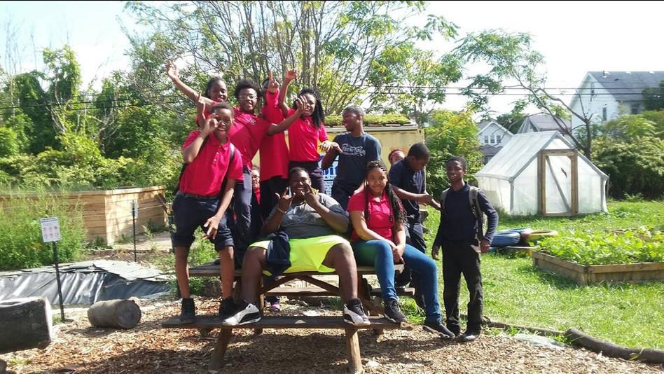 Neighborhood youth in the community garden