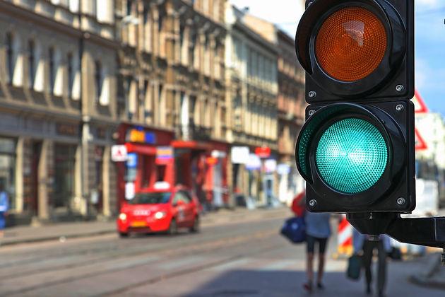 Traffic light green. Street background.j