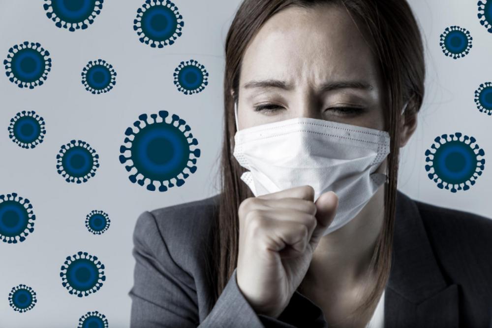 kobieta w masce otoczona wirusami