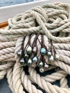 Single black pearl necklaces