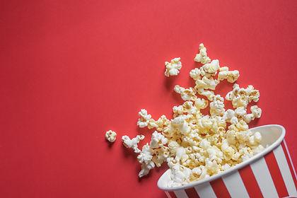 Spilled popcorn on a red background, cin