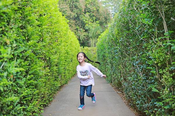 Asian little child girl running in garde