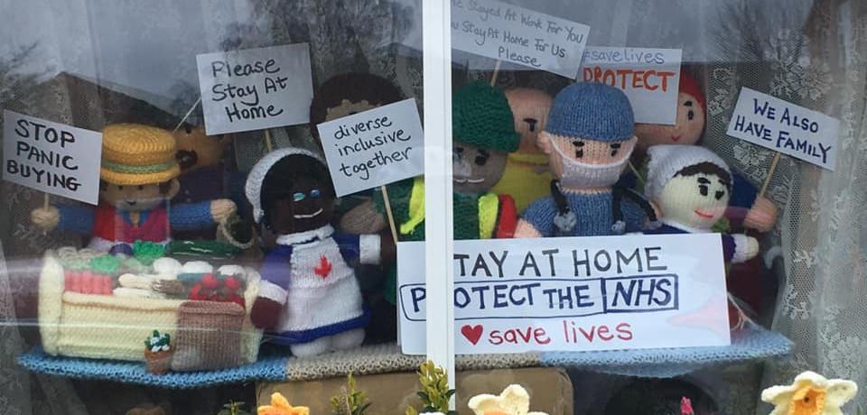 Knitted key workers in window 'spread joy'