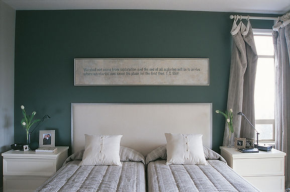 its adouble bed in a clean bed room
