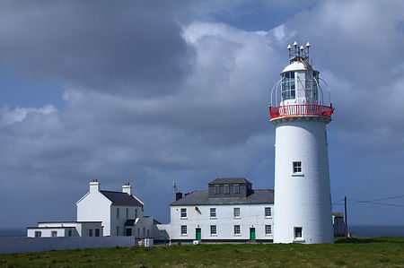 Lighthouse and sky on the Irish coast sh