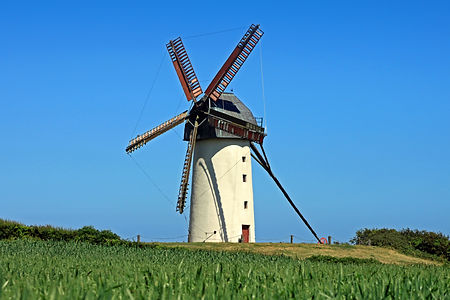 An old windmill in perfect conditon on a