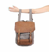 Grey and tan backpack on woman's arm