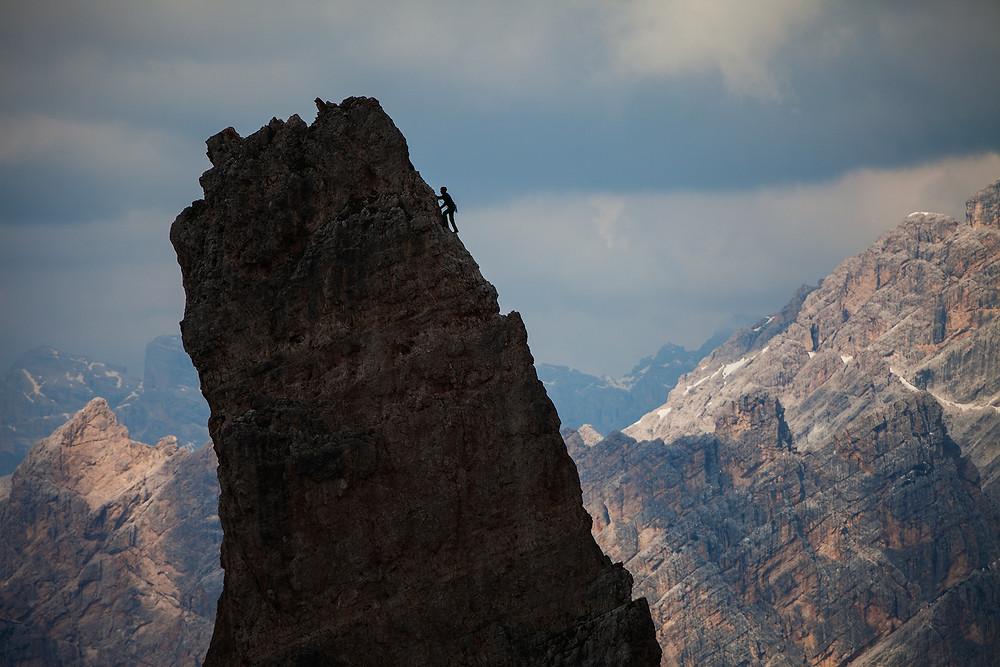 Alpinist at Cinque Torri, Dolomites, Italy