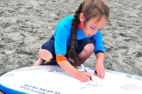 we invite kids to participate in gospel-centered messages and activities between surf sessions.