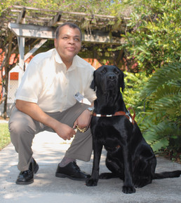 Adult male with guide dog