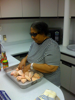 Cooking Class: A woman prepares raw chicken in a pan