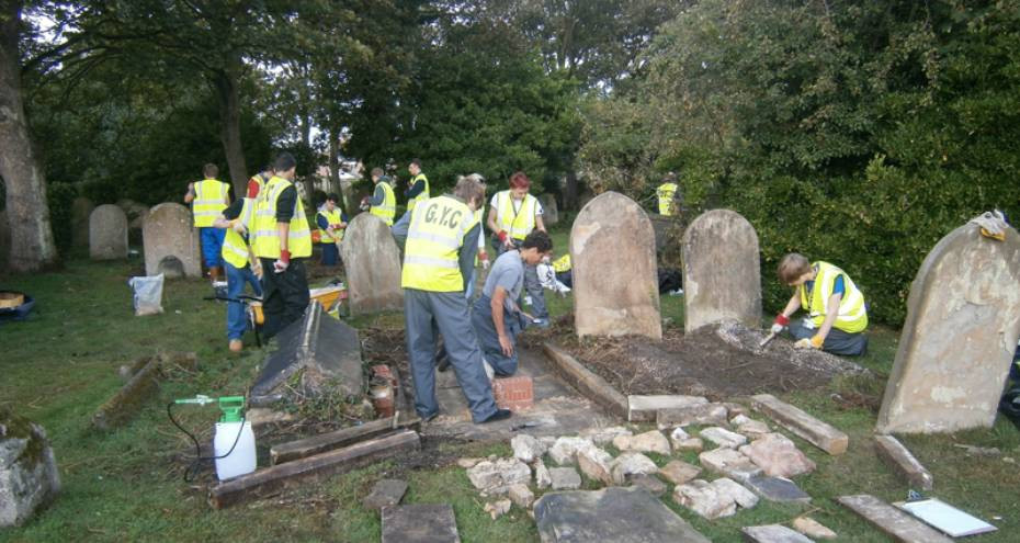 East Coast College students working in the cemeteries