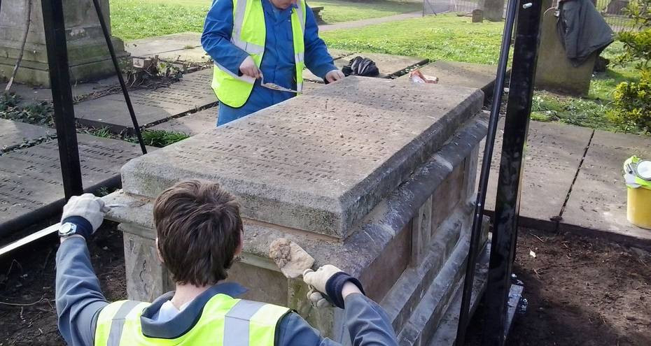 Students from East Coast College repairing a tomb