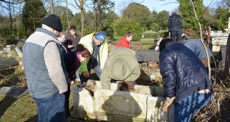 Conservation professionals John Briggs and Katie Langridge working with trainees, 2013