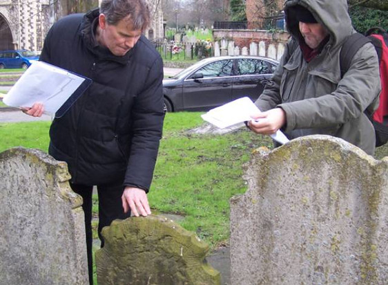 Ian demonstrating survey and recording techniques to volunteers