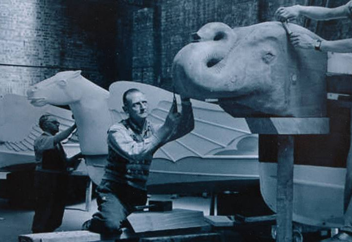 Craftsmen working on carved animal heads