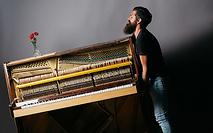 man-moving-piano_Metad.png