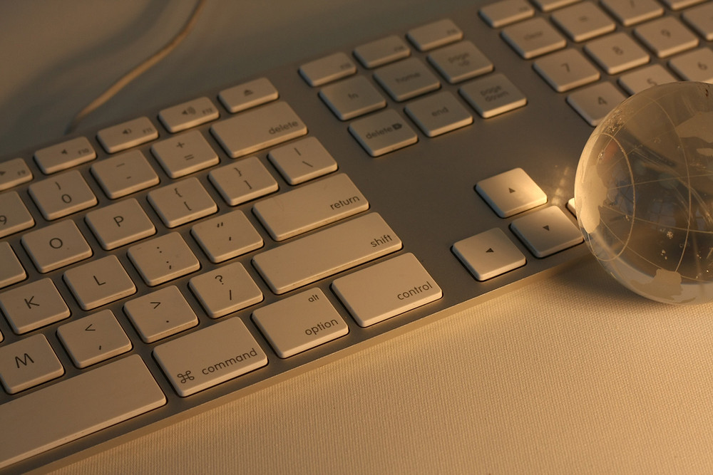 Keyboard in low light with glass globe