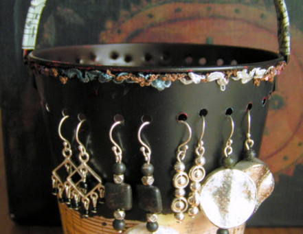 Tin pail turned earring storage