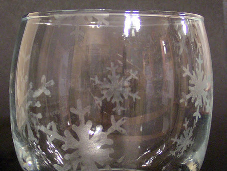 A snowflake etched votive candle holder