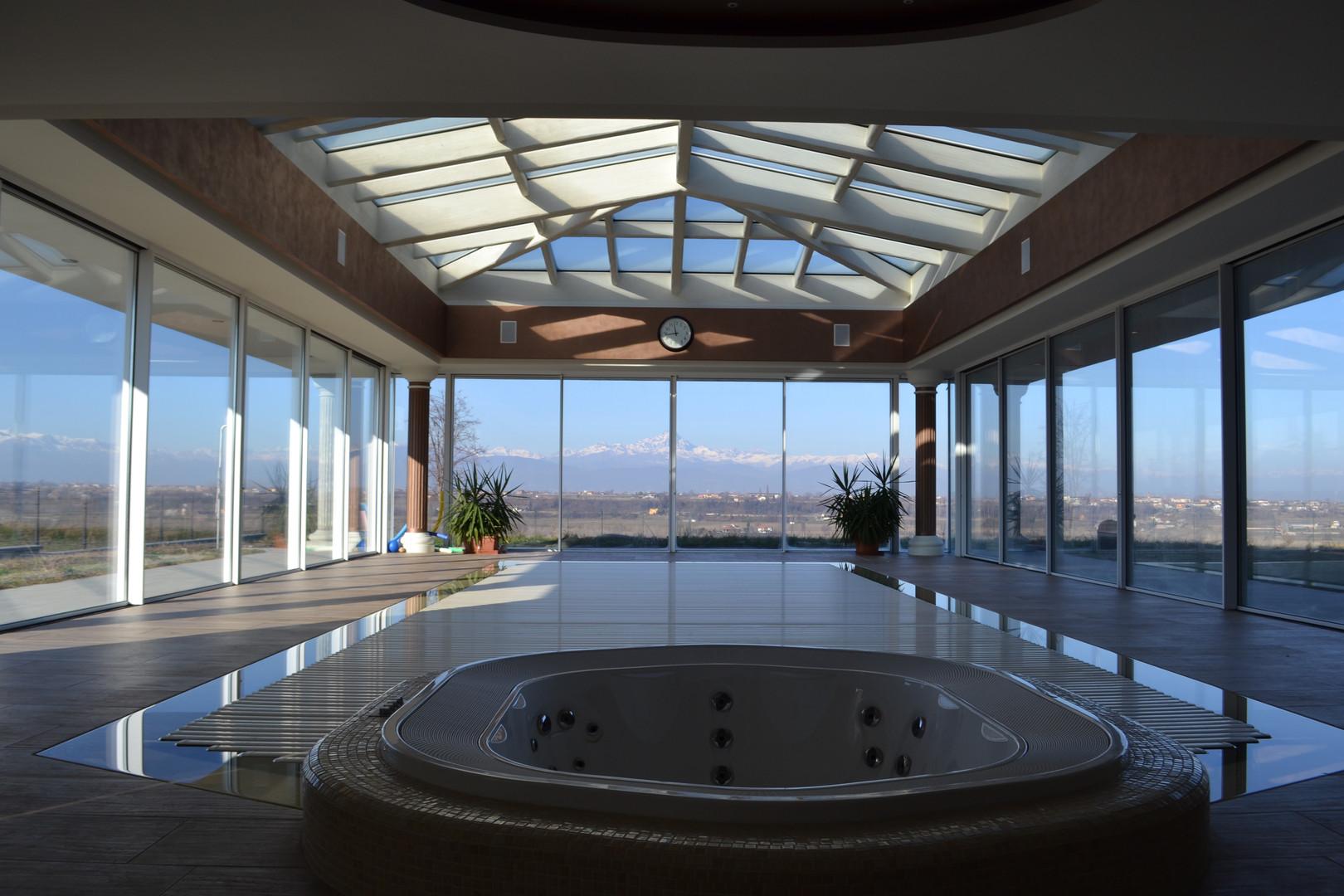 Scorrevoli slim e copertura in legno rivestita in vetro con sistema facciata continua