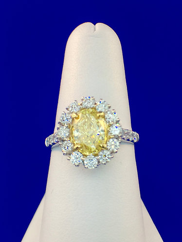 14kt. white and yellow gold Fancy Yellow oval diamond ring