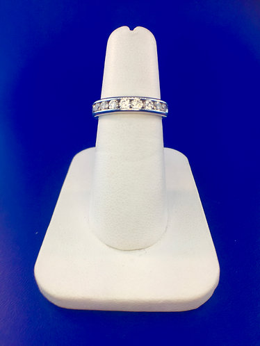 14kt. white gold channel set band with natural diamonds
