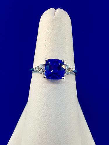 18kt. white gold  tanzanite cushion shape and diamond ring