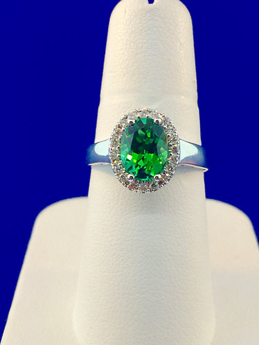 18kt. white gold oval green tourmaline ring with diamonds