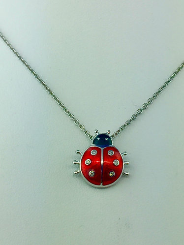 Hand made enamel lady bug pendant with sapphires