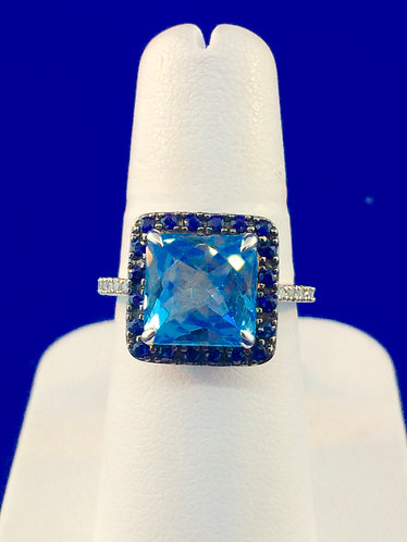 14kt. white gold with a blue topaz center surrounded by sapphires and diamonds