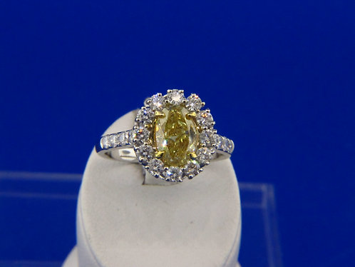1.52 ct. Natural Fancy Yellow oval diamond ring