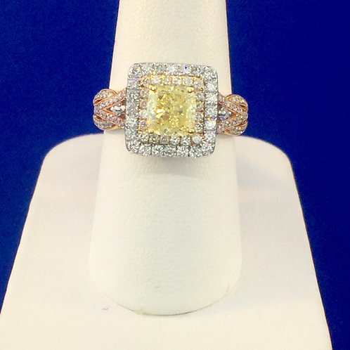 14kt. white and rose gold with a fancy yellow center diamond