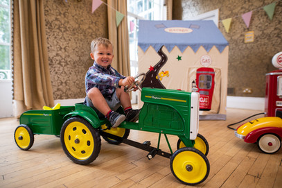 Boy playing on tractor at Dinky Drivers party.