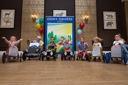 Kids enjoying Dinky Drivers event in Bristol weddin  venue.