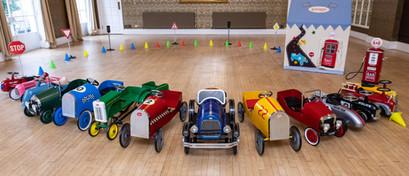 Full fleet of vintage pedal cars at weding venue in Bristol