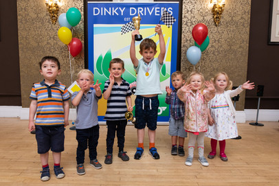 Kids celebrating their race day at event in Bristol run byDinky Drivers