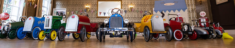 Vintagepedal cars and ride on cars arranged at wedding venue in Bristol