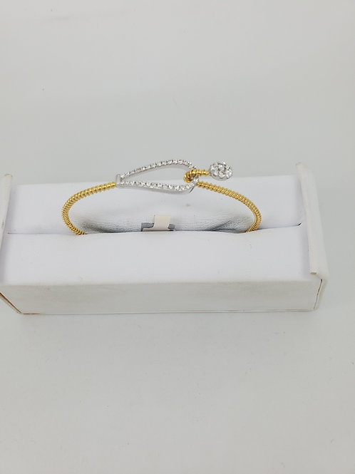 14k white and yellow gold flexible bangle with diamonds