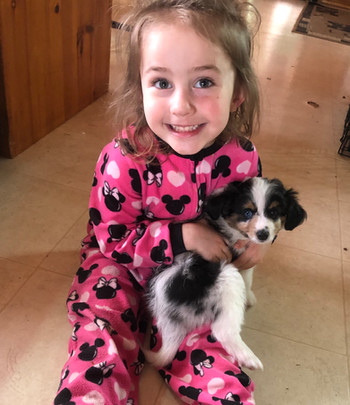 Our daughter with Rocket @ 8 weeks old