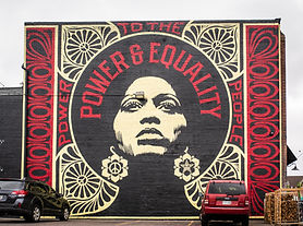 """Street artist Shepard Fairey painted his """"Power to the People"""" mural for Denver's CRUSH festival in 2018. It's located on Denver Central Market in the RiNo Art District."""
