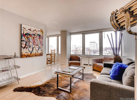 Live a city life in this corner unit in Capitol Hill