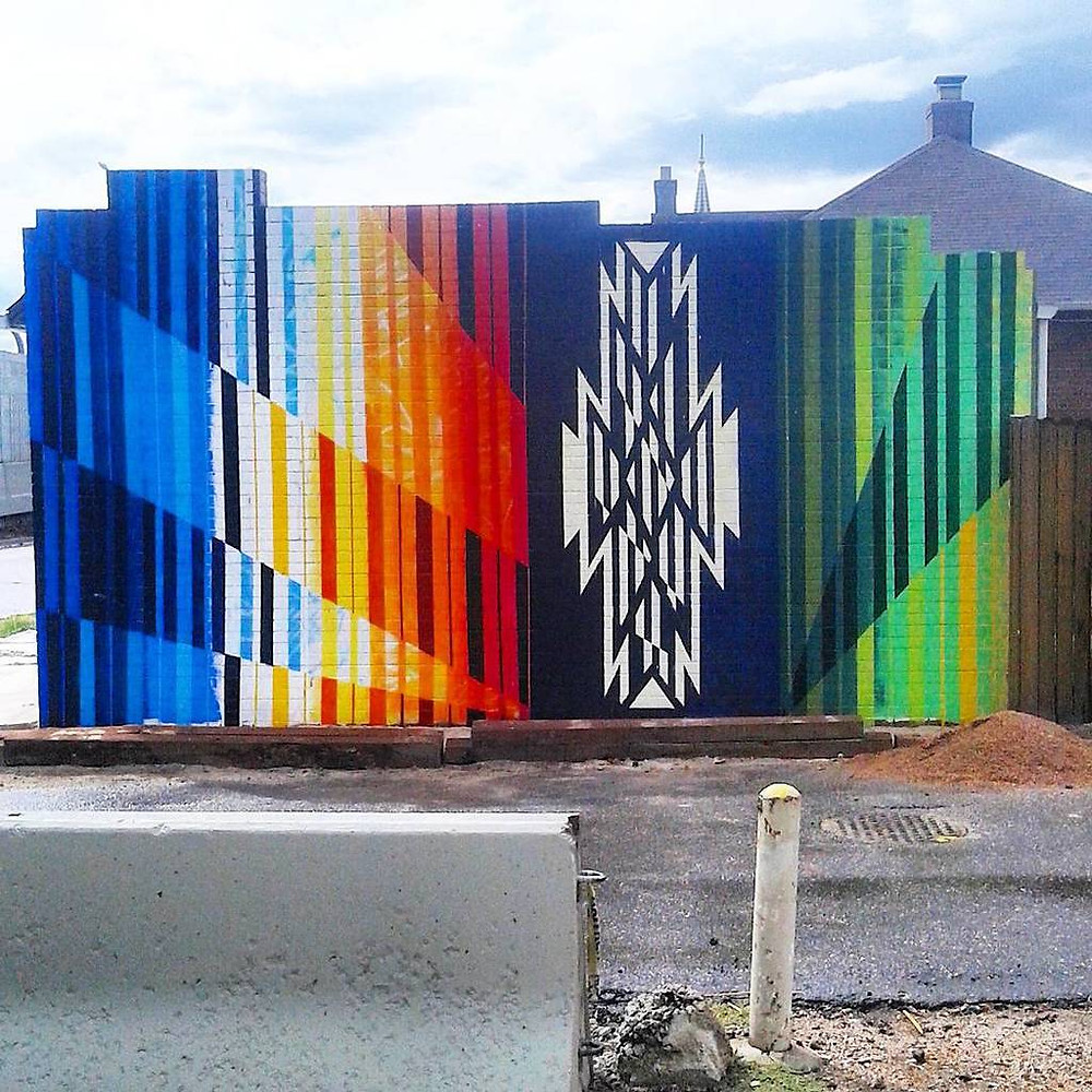 Anthony Garcia of Denver's Birdseed Collective painted this mural in the RiNo Art District.